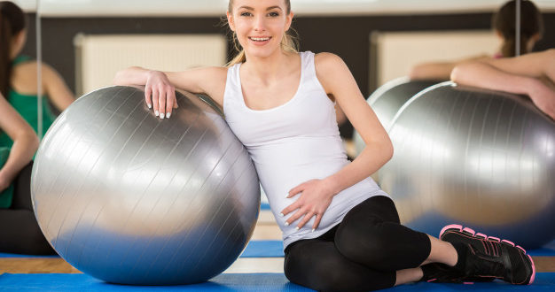 young-pregnant-woman-doing-exercise-using-fitness-ball-indian-parents-talks