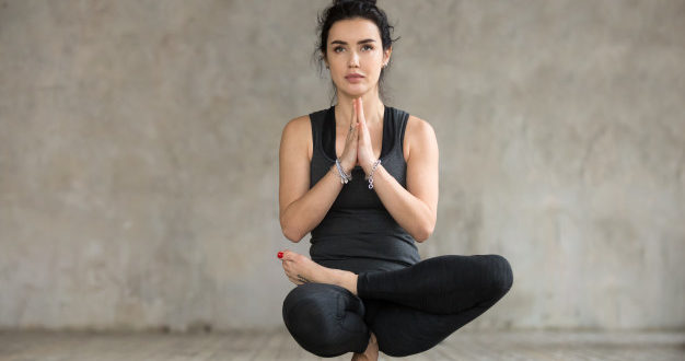 young-woman-doing-half-lotus-toe-balance-exercise-indian-parents-talks
