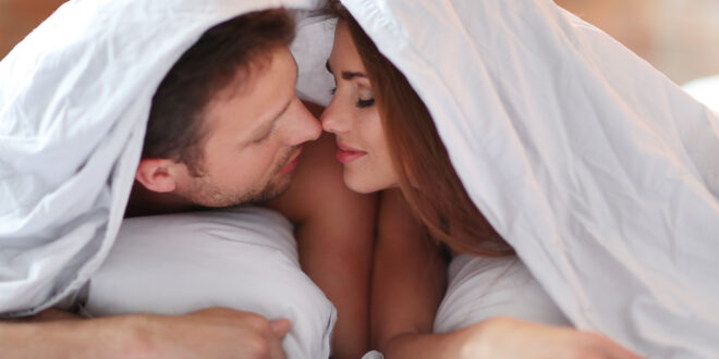 Relationship Lovely couple in bed