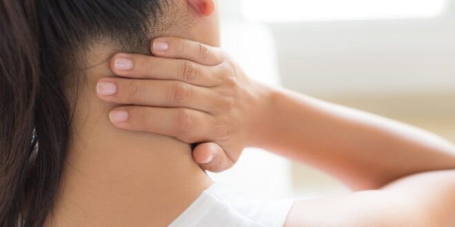Body Pain- Neck Pain-Closeup woman neck and shoulder pain and injury. Health care and medical concept.