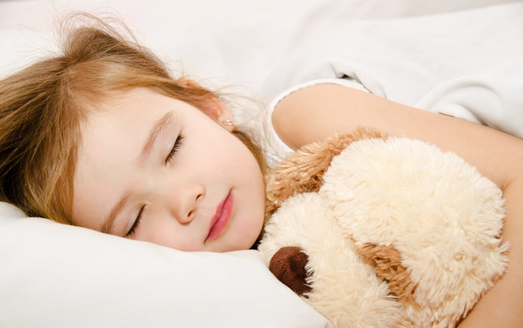 Child Adorable little girl sleeping in the bed